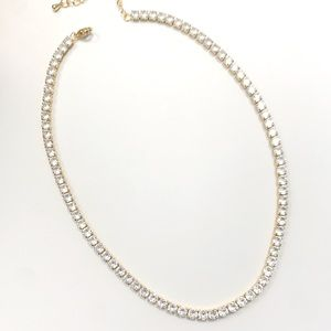 Cubic zirconia and 18k gold tennis necklace.